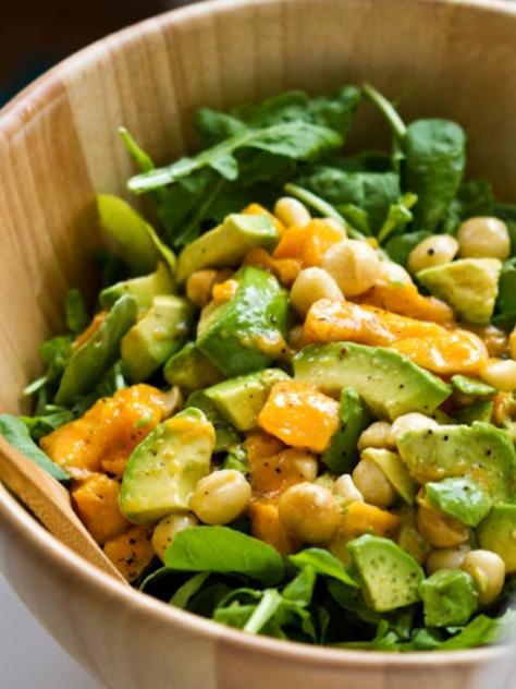 Arugula salad with mango, macadamia nuts and avocado